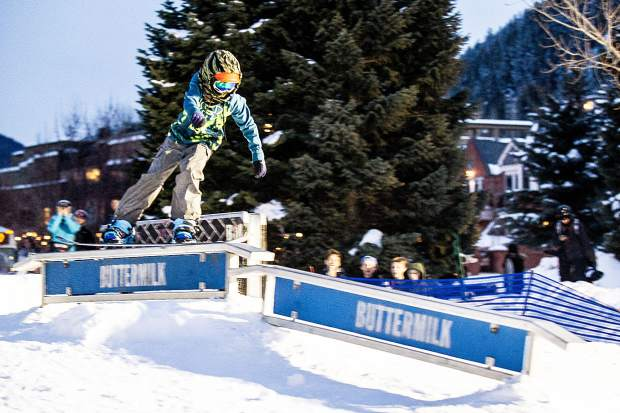 12-year-old Ryder Bollock hits the flat to down rail set up for the Winterskol Aspen Valley Ski and Snowboard Club rail jam in Wagner Park Friday.