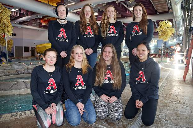 The eight state qualifiers for the Aspen High School girls swim team pose for a photo earlier in the week ahead of the 3A meet in Thornton.
