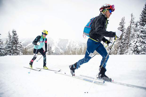 Billy Laird, right, and Brian Smith embrace at the base of Aspen Mountain after winning Saturday's Power of Four Ski Mountaineering Race.