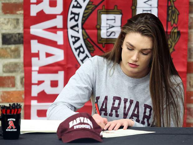 Aspen High School senior Kennidy Quist signs her letter of intent Wednesday to swim for Harvard.