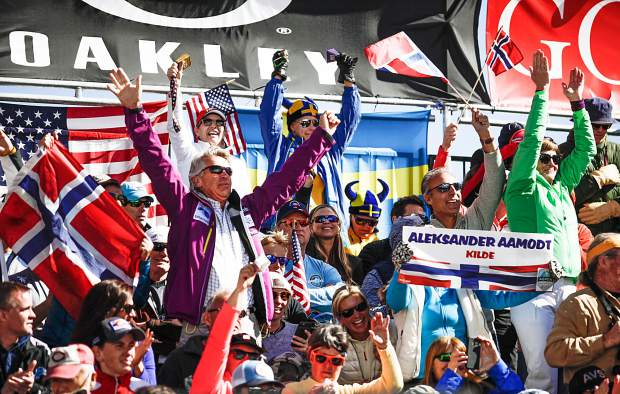 Fans cheer for ski racers during the men's and women's Super G race for the World Cup Finals on Thursday in Aspen.