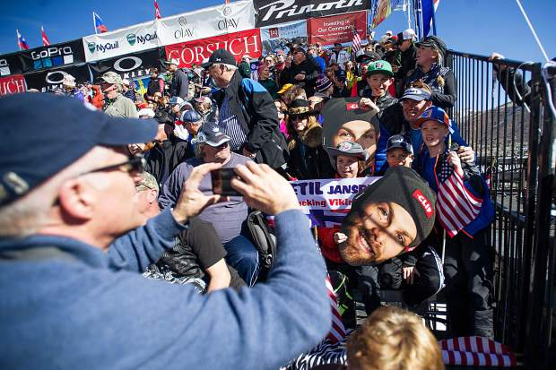 Fans in the granstand take a photo prior to the men's Super-G competition on Aspen Mountain Thursday.