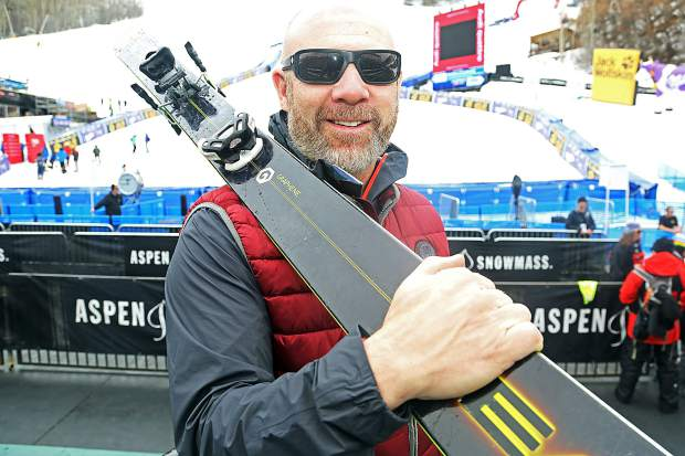 A.J. Kitt, who lives in Oregon, stops for a photo at the base of the World Cup course Monday at Aspen Mountain. Kitt was the last man to win a World Cup downhill race in Aspen, although his 1995 win was later stripped by FIS, citing unfair weather conditions that limited the number of starters.