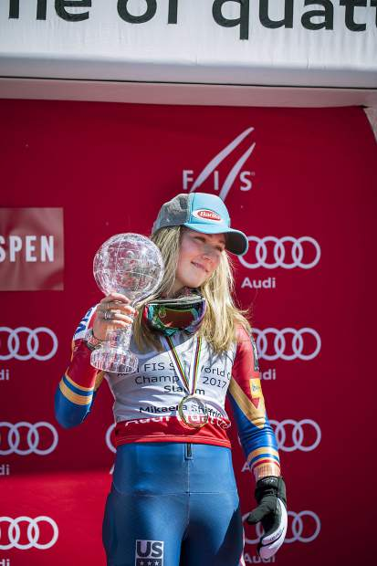 Mikaela Shriffin poses with her globe after winning overall Women's slalom at the Word Cup Finals Saturday.