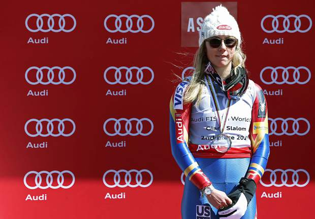 World Cup women's giant slalom overall second place finisher United States' Mikaela Shiffrin stands on the podium after a women's World Cup giant slalom ski race Sunday, March 19, 2017, in Aspen, Colo. (AP Photo/Nathan Bilow)