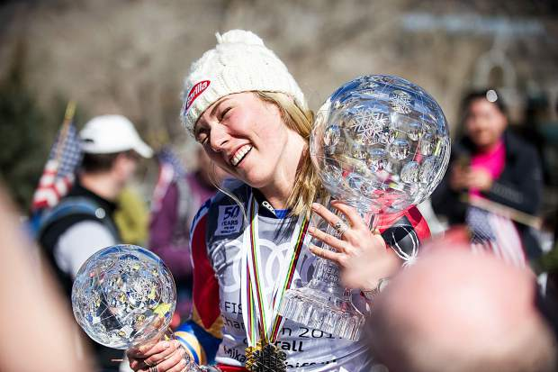 US skier Mikaela Shiffrin holding her crystal globe awards after the women's GS race on Sunday on Aspen Mountain.