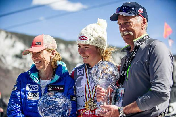 US skier Mikaela Shiffrin posing with her parents after accepting the overall crystal globe award on Sunday on Aspen Mountain.