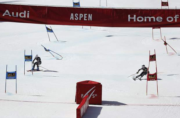Italy's Chiara Costazza, left, competes against France's Coralie Frasse Sombet during a run at a World Cup team event ski race Friday, March 17, 2017, in Aspen, Colo. (AP Photo/Brennan Linsley)