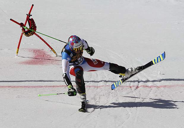 Switzerland's Luca Aerni finishes a run at a World Cup team event ski race Friday, March 17, 2017, in Aspen, Colo. (AP Photo/Brennan Linsley)