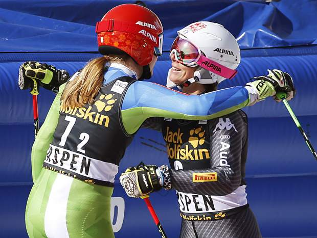 Slovenia's Ana Drev, left, and Italy's Chiara Costazza hug after skiing a run at a World Cup team event ski race Friday, March 17, 2017, in Aspen, Colo. (AP Photo/Brennan Linsley)