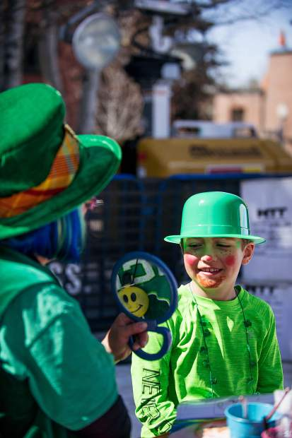1st grader Drew Kuhlman getting his face painted for St. Patrick's Day at the World Cup Village in Wagner Park.