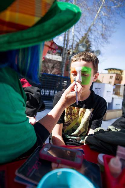3rd grader Carter Kuhlman getting his face painted for St. Patrick's Day at the World Cup Village in Wagner Park.