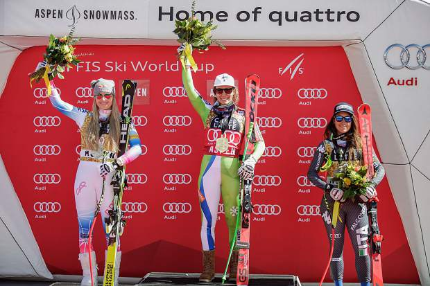 Women's World Cup downhill winners on the podium in Aspen on Wednesdasy. From left, second-place finisher Lindsey Vonn of the U.S., first-place finisher Ikla Stuhec of Slovenia and third-place finisher Italy's Sofia Goggia.