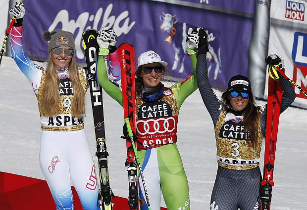 From left, second place finisher United States' Lindsey Vonn, first place finisher Slovenia's Ilka Stuhec and third place finisher Italy's Sofia Goggia celebrate at the women's World Cup downhill ski race Wednesday on Aspen Mountain.