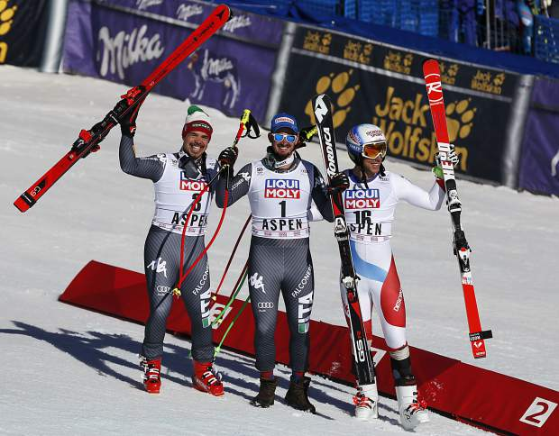 From left, second place finisher Italy's Peter Fill, first place finisher Italy's Dominik Paris and third place finisher Switzerland's Carlo Janka celebrate after the men's World Cup downhill ski race Wednesday in Aspen.