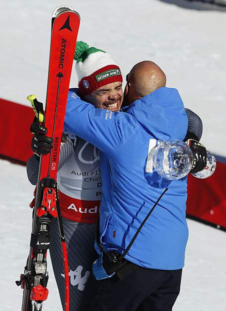 Italy's Peter Fill celebrates after a run at the men's World Cup downhill ski race Wednesda in Aspen. Fill is the winner of the crystal globe trophy after winning the world cup men's overall downhill title.
