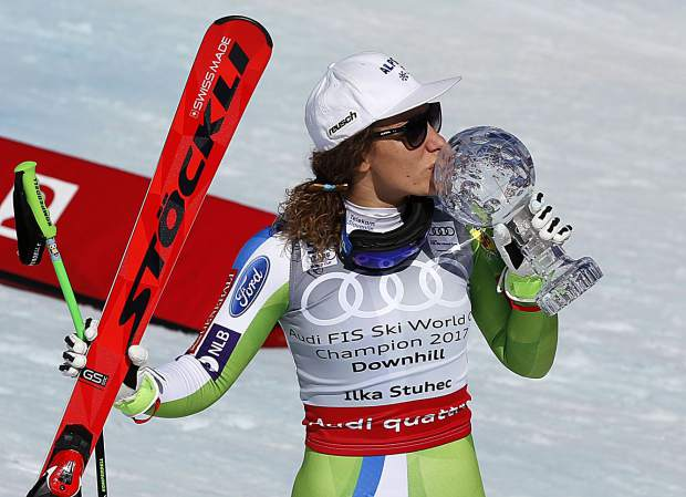 Slovenia's Ilka Stuhec kisses a trophy after a run at the women's World Cup downhill ski race Wednesday in Aspen. Stuhec received the crystal globe trophy after winning the world cup women's overall downhill title.