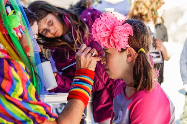 Lucy Halferty, 8, of Aspen gets her face painted by Naoma Gleason