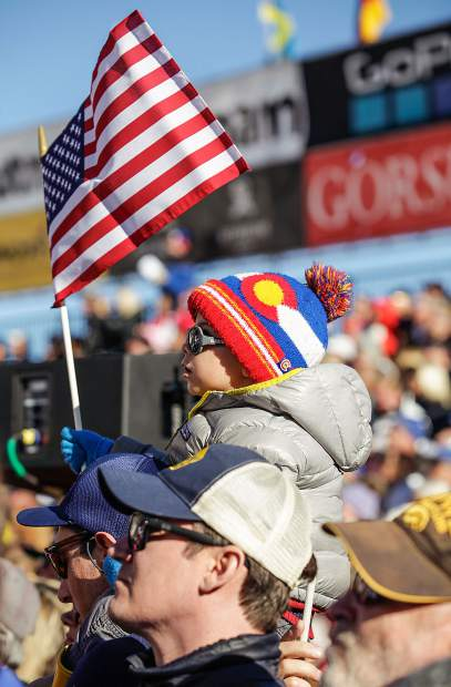Henry Shea, 3, of Aspen, waves an American flag during the downhill race for the World Cup Finals on Wednesday in Aspen.
