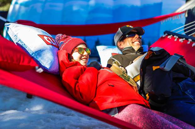 Eric and Zuri, 11, McLoughlin of Alta, Utah, relax on hammocks at Wagner Park for the FIS World Cup Finals on Wednesday in Aspen. The two say they are here for the races.