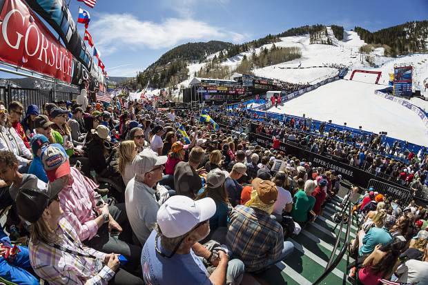 An enthusiastic crowd fills the grandstand at the finish area of the World Cup Finals Sunday.