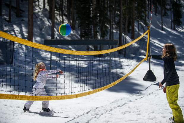 Young girls play volleball at Elk Camp at Snowmass on Saturday.