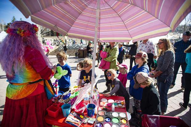 Kids have their faces painted and balloon animals made in Base Village at Snowmass on Saturday.
