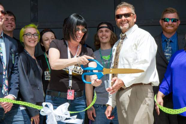 Tumbleweed Express Drive-Thru owner Sherri Marzario, left, and Parachute town manager Stuart McArthur cut the ribbon at the grand opening of the nation's first drive-through marijuana dispensery.