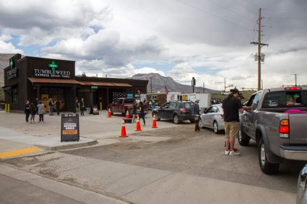 Cars wait in line at the grand opening of the Tumbleweed Express Drive-Thru in Parachute.