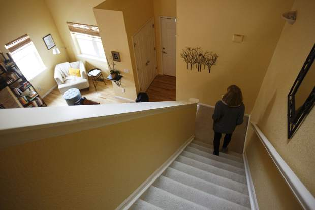 The golden walls of the Pitts home in Longmont used to be filled with two decades worth of family photos. Now, as Rebecca Vogel-Pitts prepares to sell it and move on following her husband Kevin's death at Breckenridge Ski Resort in December 2016, they lie nearly empty.