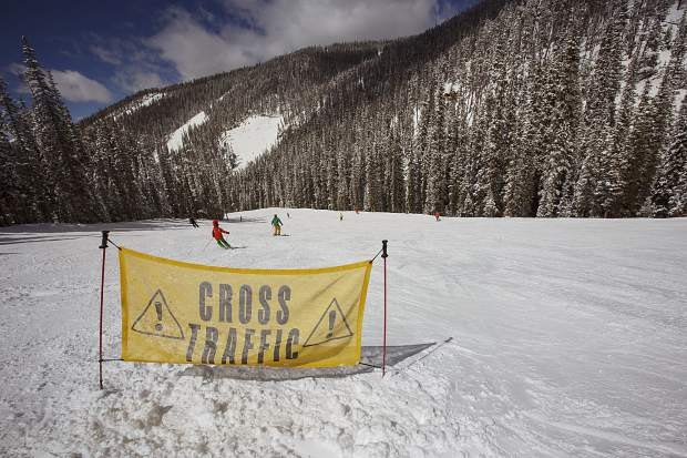 A sign at the intersection of Prospector and Alamo warns skiers and snowboarders of inbound traffic at Keystone Resort in March.