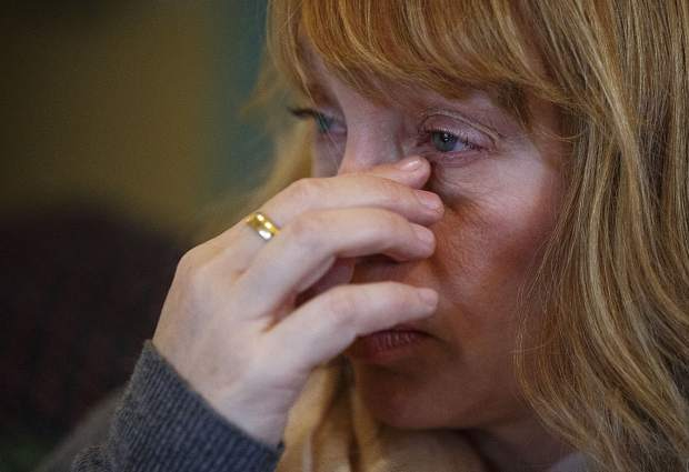 Rebecca Vogel-Pitts, of Longmont, sheds a tear in March while remembering her late husband, Kevin. He became the state's first ski-related fatality of the 2016-17 season after skiing into a tree at Breckenridge Ski Resort on Dec. 19, 2016.
