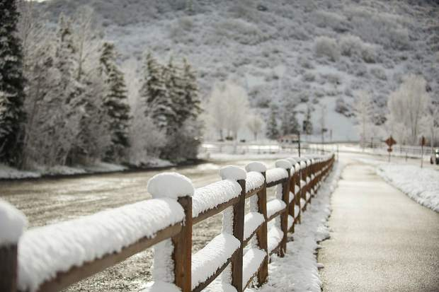 Fence posts were lined with fresh snow this morning in Snowmass.