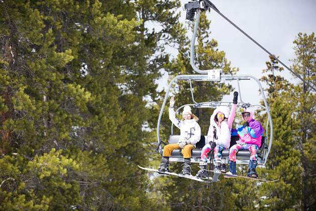 A lively trio heads up the chairlift for Aspen Highlands' closing day on Sunday.