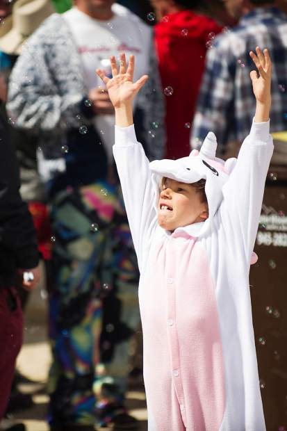 A little boy plays with bubbles dressed as a unicorn at Aspen Highlands' closing day on Sunday.