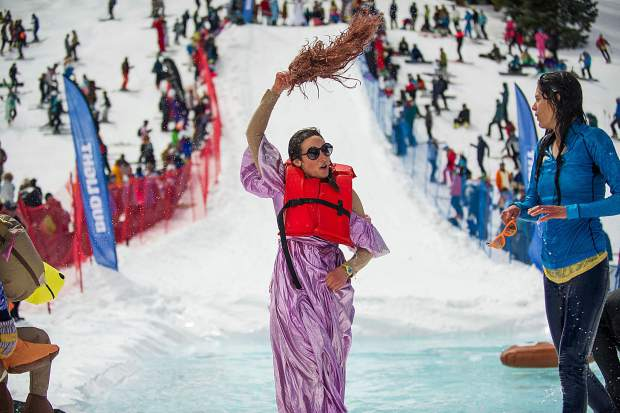 Ellie Barber whips her wig after her team competes in the Schneetag pond skim for Aspen Highlands closing day on Sunday.