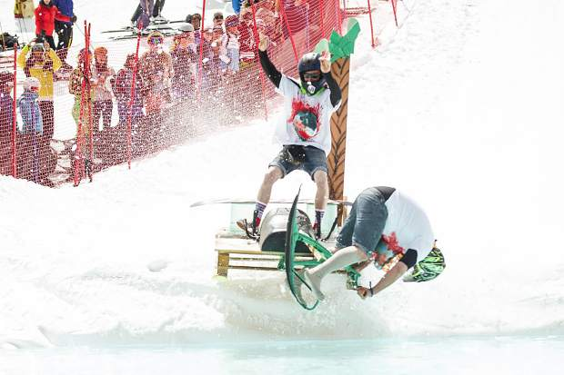 A team flips into the pond in the Schneetag pond skim for Aspen Highlands closing day on Sunday.