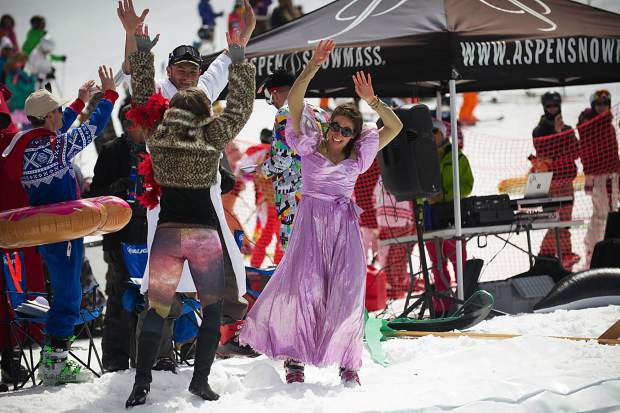 The winning team of the Schneetag competition celebrates at Aspen Highlands' closing day on Sunday.