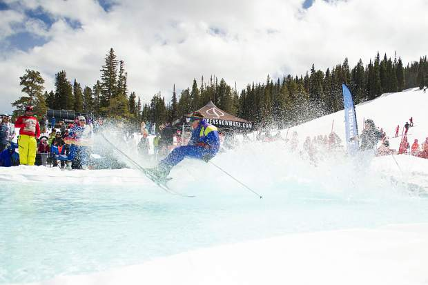 A skier skims across the pond at Aspen Highlands' closing day on Sunday.