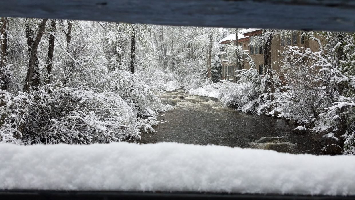 Snow covers the banks of the Roaring Fork River on Thursday.