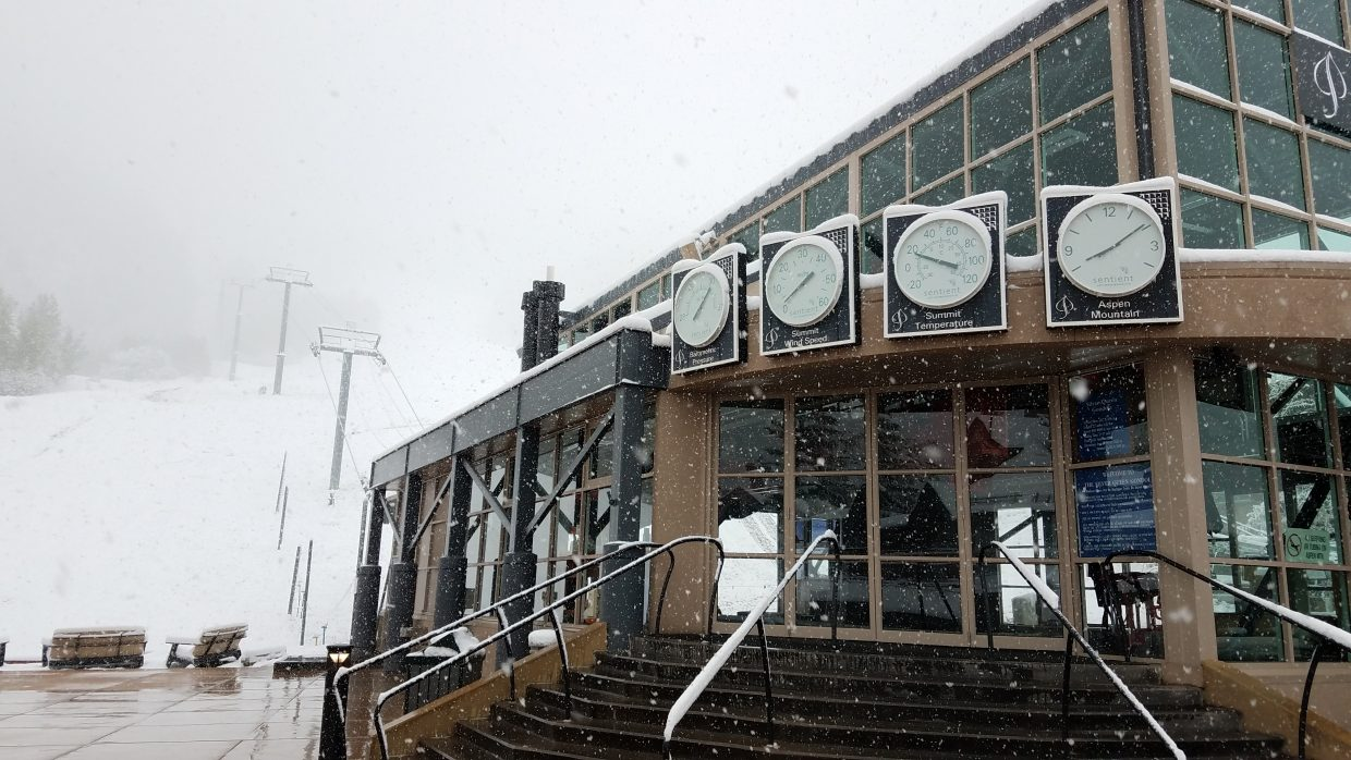The gondola at the base of Aspen Mountain sits empty amid the fresh snow Thursday.