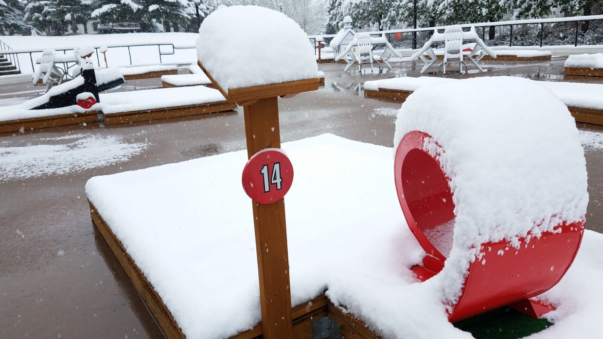 A hole at the putt-putt course near CP Burger coated with snow Thursday.