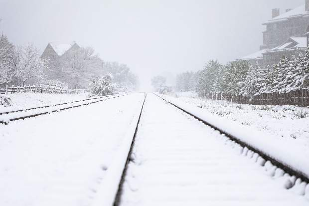 Snow covers the railroad tracks in Avon after a powerful snowstorm dropped loads of the heavy white stuff across the state on Thursday.
