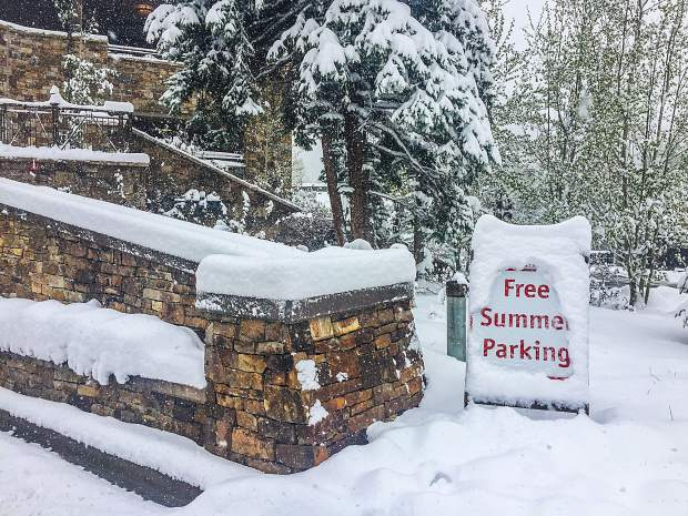 Snow covers a traffic sign at Lionshead Parking structure in Vail.
