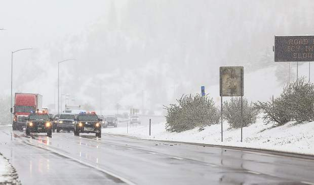 Vail Police escort traffic down eastbound Interstate 70 as Vail Pass opens after an hours-long safety closure Thursday morning.