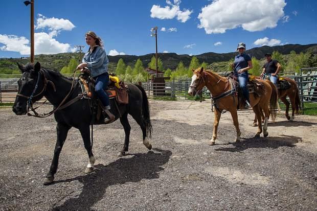 Snowmass Creek Outfitters leads a group on horses on May 26.