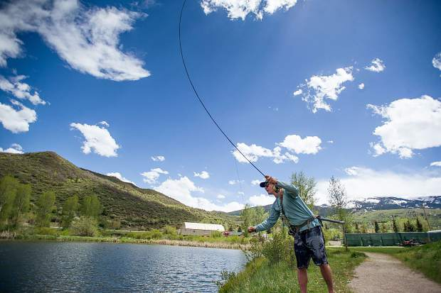A fisherman takes advantage of the recent warm weather in Snowmass Village.