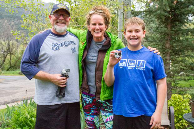 Roman Hassell, left, his son Camden, right, and the owner of the GoPro, Hailee Rustad.