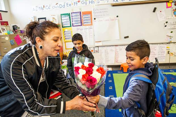 Diego Medina, 6, presents flowers to first-grade teacher Hilda Bryant at Basalt Elementary for Teacher Appreciation Week at Basalt Elementary on Wednesday.
