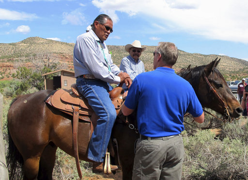 Interior Secretary Ryan Zinke, right, talks with two men on horses Monday at the Butler Wash trailhead within Bears Ears National Monument near Blanding, Utah. Zinke says he wants to make sure Native American cultural standing is preserved in a new national monument but cautioned that not all tribal members share the same opinion about it.